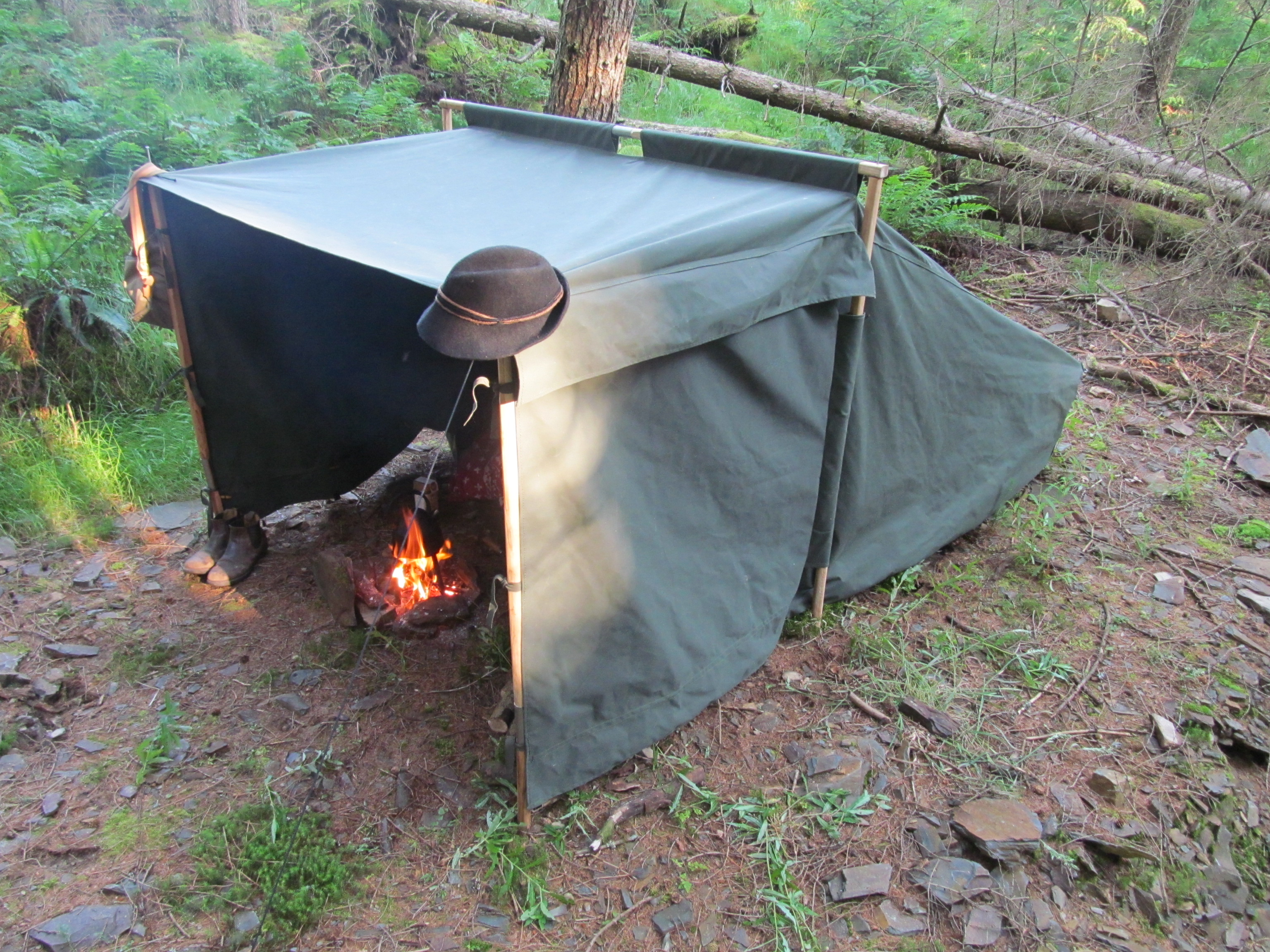 The C&fire Tent on a rocky beach on Loch Ness - secured simply to the canoes to the front and a log to the rear - no pegs needed. & The Campfire Tent on a rocky beach on Loch Ness - secured simply to ...