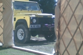 Defender expedition vehicle in yurt door